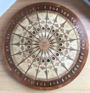 The instructive side of the Badí' Calendar Teaching Puzzle showing words and numbers for the month of Bahá (Splendor), the first month of the Badí' calendar