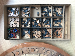 The many pieces needed to assemble the Badí' Calendar Puzzler