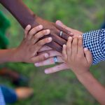 Hands of family members joined in a circle