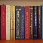 Baha'i texts on a bookshelf