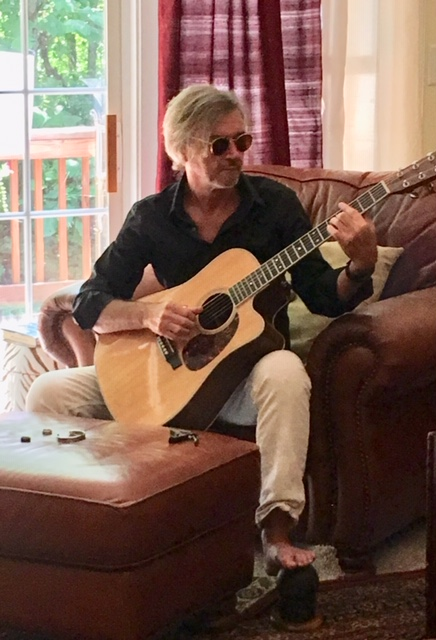 Pete Jordan playing his guitar